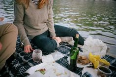 Parisian summer = sitting along the Seine with friends, a few bottles of wine, fresh bread, cheese, radishes, and butter
