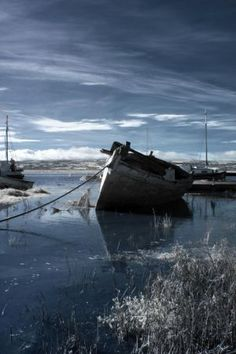 Infrared Image of the semi-retired old boats lying on tidal marshes at Heswall on the Dee, Wirral