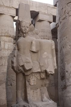 ✮ The ruins of a statue stand at the entrance to the hypostyle hall - Egypt