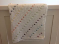 A hand knitted baby blanket with colourful stitch detail. Knitted in soft yarn - warm and comfortable for baby. This blanket is already made and ready to ship. Dimensions: 27 x 27 inches A great gift for a special baby. Knitted Baby Blankets, Baby Cartoon, Baby Socks, Baby Knitting, Pure Products, Wool, Stitch, Sewing, Crochet