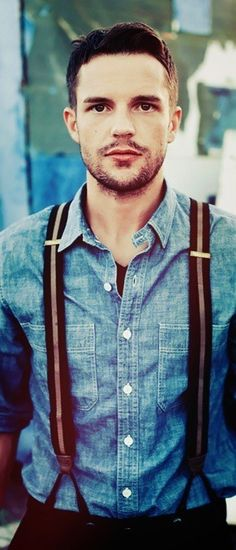 Suspenders, denim chambray, and a 5O'clock shadow.