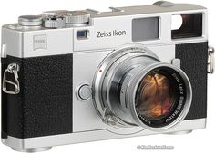 Zeiss Ikon in silver (modern) and Leica collapsible 5cm f/2 Summicron (1954).