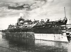 USS Oklahoma 26 months after sinking. In 1947 she was being towed from Hawaii to SanFrancisco to be scrapped and the two tugs encountered a storm. The ship took on water and sank rapidly almost taking one of the tugs with her. Oklahoma's final resting place is unknown to this day.