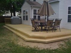 Raised wood deck designed with step-down surround