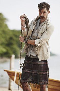 John Varvatos' cotton blazer, Haider Ackermann's silk vest, Gucci's linen T-shirt, and Paul Smith's cotton shorts. [Photo by Billy Kidd]