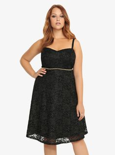 Oozing with rich, elegant detail, this black adjustable-strap dress shimmers with a hint of gold. Chain trim at the waistline breaks up a fitted bodice from an easy flowing skirt to give you one stellar look that will attract plenty of attention.