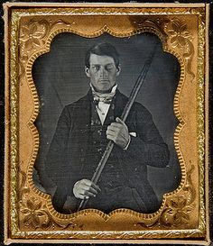 Phineas Gage holding the railroad spike that went through his eye socket and out the back of his head in 1848. Gage survived, but with an altered personality, making this a landmark case in the history of neurology.