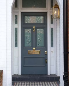 Victorian etched glass door with bespoke glazed panels and stylish brass door furniture. Finished by hand in high quality matte grey paint. Cottage Front Doors, Victorian Front Doors, Yellow Front Doors, Wooden Front Doors, Front Door Entrance, House Front Door, Painted Front Doors, Front Door Colors, Dark Grey Front Door