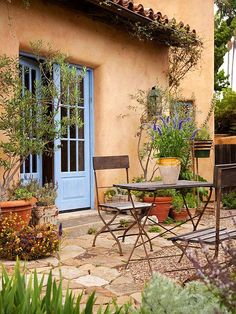 Give Your Yard a Boost - With flagstone, you can easily make an outdoor patio in a weekend -- no mortar required. Add potted plants and outdoor seating, such as a bistro set or an eclectic mix of colorful chairs, to create a quaint backyard escape. Small Outdoor Spaces, Outdoor Rooms, Outdoor Gardens, Outdoor Living, Outdoor Decor, Outdoor Seating, Casa Patio, Adobe House, Spanish Style