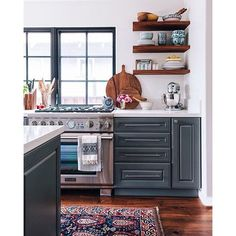 Image result for navy kitchen cabinets and opening shelving