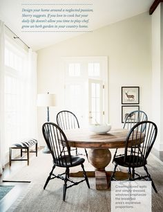 Round table with black chairs. Love the contrasting wood tones.