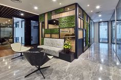 Bringing nature inside to create a soothing aura with green surroundings, for a inspiring, supportive workplace that exudes the company's team ethos to create a sense of belonging for staff Office Lounge, Green Walls, Workplace, Spaces, Boho, Create, Nature, Furniture, Home Decor