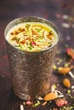 This Indian Kesar Badam Milk is loaded with goodness of almonds and saffron and is a treat to sip on. Check out this super easy to make it at home and enjoy it either chilled or hot. Here is how to make kesar badam milk. Dessert Drinks, Yummy Drinks, Healthy Drinks, Yummy Food, Healthy Milk, Milk Recipes, Vegetarian Recipes, Cooking Recipes, Healthy Recipes