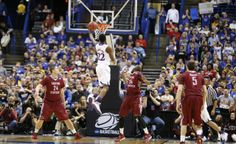 Kansas guard Andrew Wiggins cuts to the bucket for a layup against Eastern Kentucky during the first half on Friday, March 21, 2014 at Scottrade Center in St. Louis. #KU
