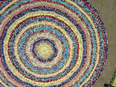 Multi colored round rug  /  56 inches in diameter / by gramsheart, $79.90. SOLD
