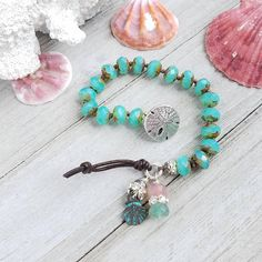 Beach Boho Bracelet: Each 'SassyKnots' bracelet features hand-selected charms and buttons, designed to accentuate the Czech glass beads and pearls. Available in an array of fetching colors, I will be adding more all the time!! Tropical aqua blue milky opal Czech glass beads with a heavy