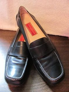 This hot little number by Cole Haan will satisfy your every style craving    COLE HAAN    WOMENS BLACK    LEATHER LOAFERS    SIZE 9.5M    WHITE CONTRASTING STICHING    EXCELLENT CONDITION    FOR PREOWNED    WRITING ON BOTTOM OF SHOE    PADDED INSOLE    VERY COMFY    NIKE AIR SOLE    WONDERFUL ADDITION    TO YOUR WARDROBE
