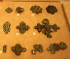 Blurry, spiral decorations for viking age garb. exhibited in the national museum of helsinki