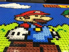Our Lego Super Mario Bros table top collage is complete! We designed and created a Super Mario scene completely out of Lego for our design studio Lego Mario, Lego Super Mario, Mario Toys, Mario Bros., Mario Party, Super Mario Bros, Mario Crafts, Kid Crafts, Lego Wall Art