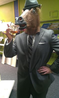 Have a sip   27 Things You Can Do While Wearing A Horse Mask