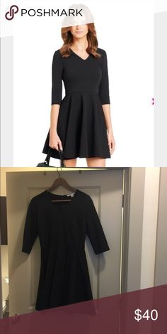 Black DVF Jeannie A-line dress, V-neck, 3/4 sleeve Black Diane von Furstenberg Jeannie A-line dress with V-neck, three-quarter sleeves and concealed zip closure at center back.  Very gently worn and in excellent condition. Sadly no longer fits. Diane Von Furstenberg Dresses Mini