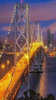 'Yellow Brick Road' Bay Bridge at night, San Francisco. The Bay bridge connects the Berkley area and the south with the city of San Francisco. Places To Travel, Places To See, Places Around The World, Around The Worlds, Yellow Brick Road, To Infinity And Beyond, Travel Usa, Wonders Of The World, Beautiful Places