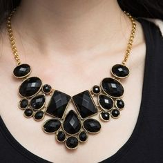 Bib statement chunky necklace Black necklace choker. It's not top quality but that's why price is so low. Still a great necklace. It's new, never wore. Black with gold colored chain. Fashion statement jewelry. Not real gemstones. Dress up any outfit. Jewelry Necklaces