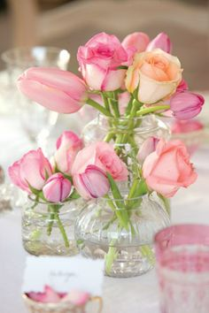 A simple nosegay of roses and tulips can make any table setting special.