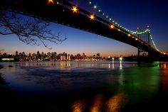 RFK Bridge, East River and Manhattan from Astoria, Queens NYC.