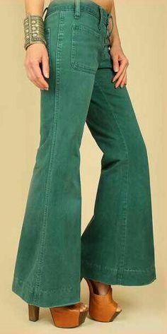 "1970s Dark Green Elephant Hip Hugger Bell Bottom Jeans. This is typical of the pants I wore in high school in the 70's. Now it's known as ""vintage"". You know you're getting old when this happens ;-) Oh well, your only as old as you feel right?"