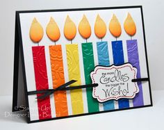 Rainbow Birthday Candles by labullard - Cards and Paper Crafts at Splitcoaststampers...cut the 1/2 x 2 3/4 inch strips of cardstock for the candles, start w/ the center green candle & then measure 3/16 in. between them...flames are saffron cardstock...sponge the lower half w/ pumpkin pie & the very bttom w/ dusty durango...the tips use a glitter pen...