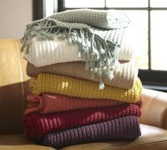 The texture of the blankets look really cozy and soft, the colours also look very warm and inviting. Definitely the kind of blanket you would want to curl up on the sofa with.
