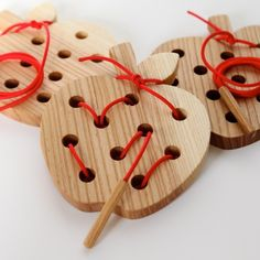 Wormy Apple! Wooden Lacing and Threading Toy. This would be a great first project to use my new dremel tool! Maybe hearts for Valentine's Day!