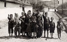 This picture shows Jewish children being forced to give German soldiers a Nazi salute. The children are smiling, perhaps having no other choice, and appear not to understand that they have become a pawn in the hands of soldiers who have lost their humanity