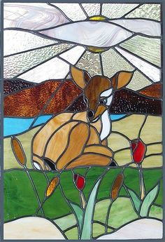 Stained Glass Deer laying in grass