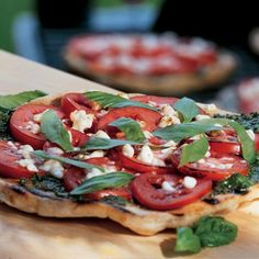 Grilled Pizza with Pesto, Tomatoes, and Feta, from Seren. Clean Eating.