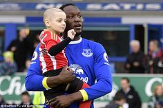 Bradley gets a hug from Everton striker Romelu Lukaku at Goodison park in January