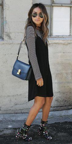 Julie Sarinana + black cotton slip dress + simple black and white striped long sleeved tee + small square navy shoulder bag + floral ankle boots. Dress: Simply Jules, Boots: Valentino, Striped Tee: Paige, Bag: Celine.