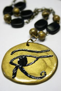 Egyptian symbol, Eye of Horus Pendant, Polymer Clay Necklace, Bronze and Black, SALE was - 100.00