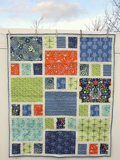 quilt by Amy Smart.  really like the simple design, but would do different colours.