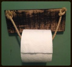 Rope toilet paper holder.