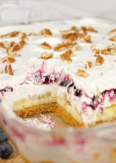 Blueberry Cheesecake Surprise: layers of cheesecake, blueberries, cool whip, (and surprise - bananas) over a graham cracker crust makes this sweet treat the hit of any get-together! (blueberry suprise, blueberry delite)