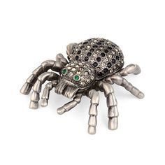 """Jeweled Spider Trinket Box Item No. KB00372A01 $20.29 This pewter based trinket box is decorated with black and white Austrian crystals that have been hand placed in perfect order to make stripes. The eyes are green, and this cool spider opens up to a beautiful turquoise color. This is the perfect gift for the spider-lover in your life, or perhaps someone who loves all animals."""