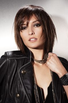 This mid-length layered haircut is neck-length at its longest points, with tapered forward edges and a light fringe.