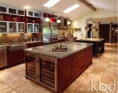Large kitchen with wooden cabinetry and gorgeous counter tops-Home and Garden Design Ideas