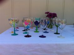 Painted wine glasses as party favors. Everyone chooses their own unique glass to drink from that day and to take home with them. The best part is, no one wonders who's glass is who's!
