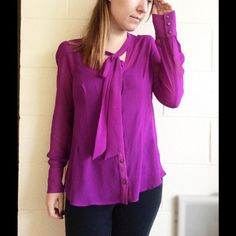 Neon Purple Blouse Tag says size small but best fit for a medium. Tie in front around neck. Button down in front. Sheer material. Form fitted. No flaws. Tops Blouses