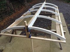 Curved timber roof structure for shepherd huts