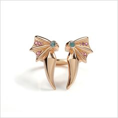 A beautiful rose gold plated ring with double wings that sit perfectly on top of the finger