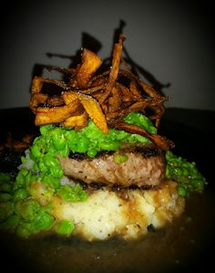 Beef medallion served on lemon & pepper parsnips with smashed peas and sweet potato chips